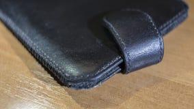 手机特写镜头的皮革盒 免版税库存照片