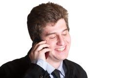手机的年轻商人 免版税库存照片