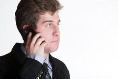 手机的年轻商人 免版税库存图片