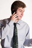 手机的年轻商人 库存照片