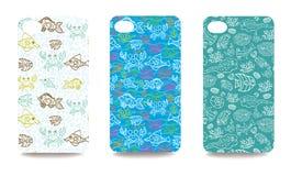 手机盖子设置了与海洋生活样式 图库摄影