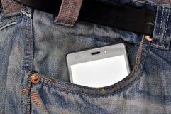 手机,在口袋蓝色牛仔裤的手机 免版税库存图片