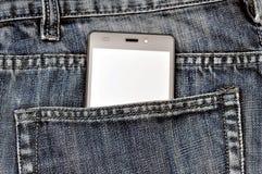 手机,在后面口袋蓝色牛仔裤的手机 免版税库存照片