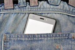 手机,在后面口袋蓝色牛仔裤的手机 图库摄影