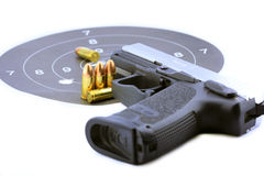 手枪和项目符号 图库摄影