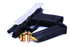 手枪和项目符号 库存照片