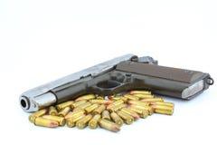 手枪和项目符号 免版税库存图片