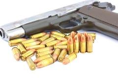 手枪和项目符号 库存图片