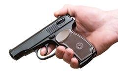 手枪在一个人的手上被隔绝 图库摄影