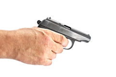 手枪在手中 免版税库存图片