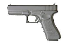 手枪接近的侧视图  免版税库存照片