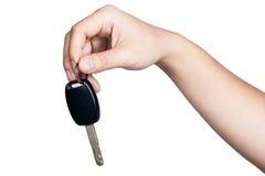 手标志姿势举行被隔绝的汽车钥匙 免版税库存图片