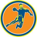 手球球员跳跃的投掷的球圈子木刻 免版税图库摄影