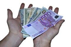 手给一百美元和欧洲钞票在白色背景 库存图片