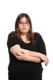 手肘女孩被伤害 免版税库存照片