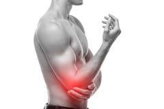 手肘痛苦经常是由过度使用造成的 许多体育、爱好和工作要求反复手、腕子或者胳膊运动 免版税库存照片