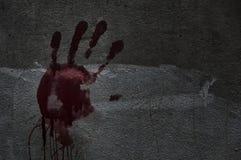 手血液在墙壁上的在被放弃的安置他们 故事土佬 免版税库存图片