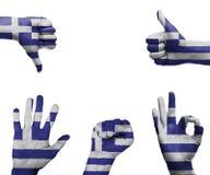 手设置与希腊的旗子 库存图片