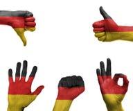 手设置与德国的旗子 库存照片