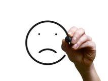 手画与黑标志的哀伤的面带笑容 免版税库存图片