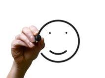 手画与黑标志的愉快的面带笑容 库存图片