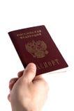 手给俄国护照 图库摄影