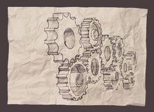 手画齿轮对在被弄皱的纸的成功概念 免版税库存图片