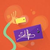 手Selfie照片举行五颜六色的聪明的电话作为 免版税库存照片