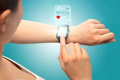 手smartwatch概念 图库摄影
