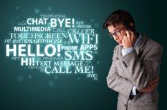 打与词云彩的年轻人电话 免版税库存图片