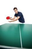 打乒乓球的确信的男性运动员 库存图片