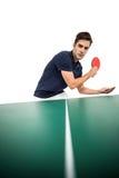打乒乓球的确信的男性运动员 图库摄影