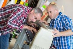 打印机检查质量机器,当打印时 免版税库存照片