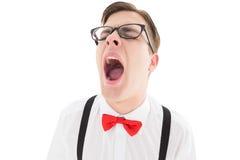 打呵欠在悬挂装置和蝶形领结的讨厌的行家 免版税库存照片