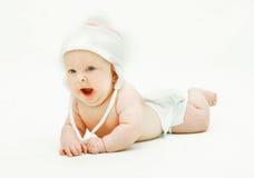 打呵欠婴孩的帽子 免版税库存照片