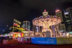 打在一个大狂欢节的人们比赛在亚洲的金融中心的心脏 免版税库存图片