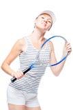 打在她的业余时间的女孩网球,画象 免版税库存图片