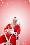 打在数字式个人计算机的圣诞老人的综合图象比赛 免版税库存照片