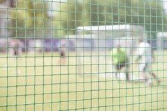 打在运动场的足球赛,在沥青的足球比赛 为足球战斗在体育门 橄榄球 图库摄影