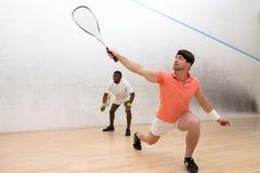 打墙网球的人 免版税图库摄影