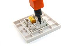 打孔机rj45插口下来工具墙壁 免版税库存图片