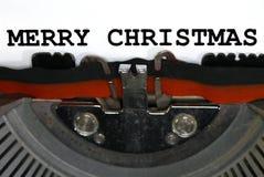 打字机键入圣诞快乐特写镜头 库存图片