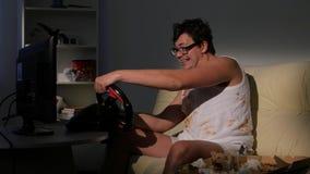打家庭网络游戏的游戏玩家人使用方向盘 股票录像