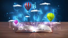 打开与发光的幻想抽象云彩和气球的书 图库摄影