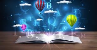 打开与发光的幻想抽象云彩和气球的书 免版税库存照片