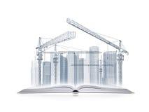 打开书和导线框架摩天大楼 免版税库存照片