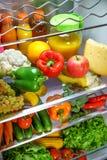 打开冰箱充满食物 免版税图库摄影
