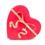 打开在心脏形状的礼物盒与弓 免版税库存图片