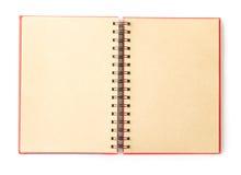 打开在白色背景的红色笔记本 免版税库存照片