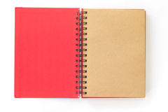 打开在白色背景的红色笔记本 库存图片